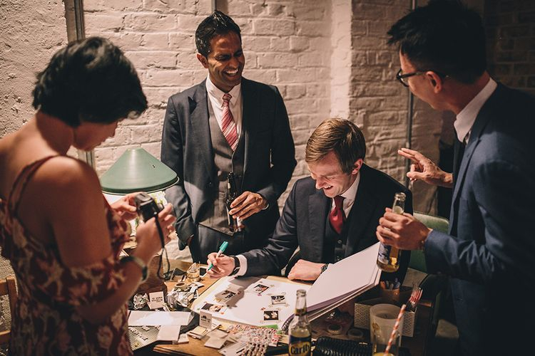 Polaroid Station Guest Book   Stylish London Wedding Planned by Revelry Events   Story + Colour Photography