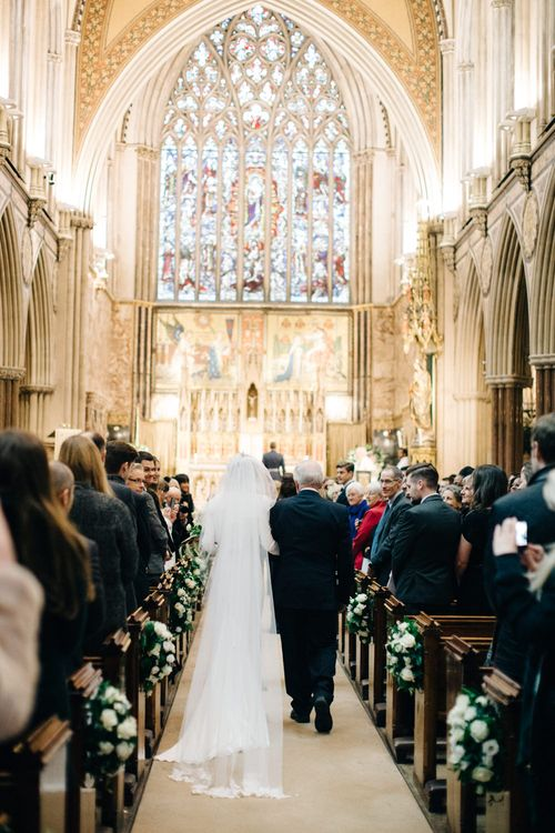Church Bridal Entrance with Bride in Charlotte Simpson Wedding Dress