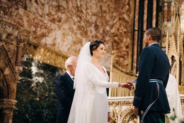Wedding Ceremony with Bride in Charlotte Simpson Wedding Dress
