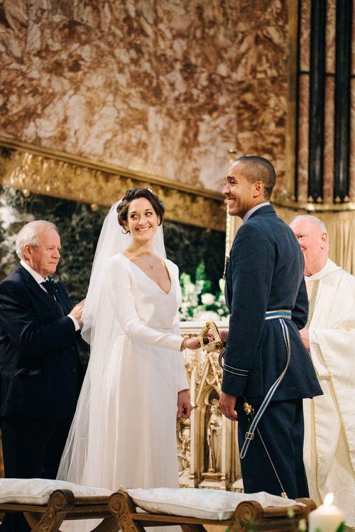 Wedding Ceremony with Bride in Charlotte Simpson Wedding Dress & Groom in Military Uniform
