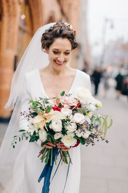 Bride in Charlotte Simpson Wedding Dress
