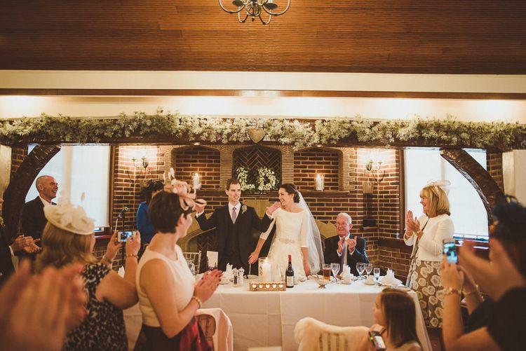 Top Table Decor   Bride in JLM Couture Ti-Adora Wedding Dress   Groom in Moss Bros Suit   Matt Penberthy Photography