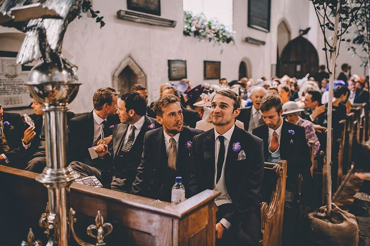 Groom at the Church Altar in Traditional Charlie Casey Hayford Morning Suit | Classic Marquee Wedding at Kimberley Hall in Norfolk | Story + Colour Photography | Driftend Films