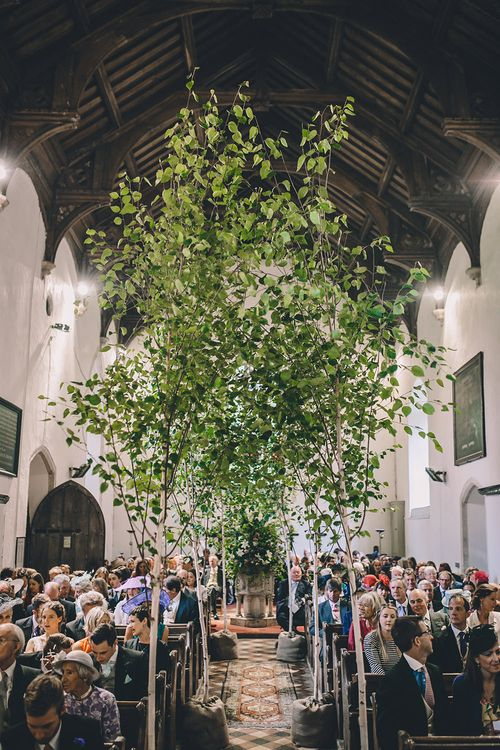 Tree Church Aisle Flowers | Classic Marquee Wedding at Kimberley Hall in Norfolk | Story + Colour Photography | Driftend Films