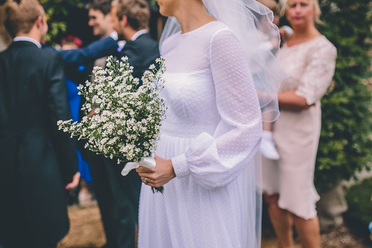 Daisy Bouquet | Bride in Polka Dot Tulle Eponine London Gown | Classic Marquee Wedding at Kimberley Hall in Norfolk | Story + Colour Photography | Driftend Films