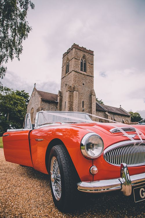 Red Convertible Wedding Car | Church Wedding Ceremony | Classic Marquee Wedding at Kimberley Hall in Norfolk | Story + Colour Photography | Driftend Films