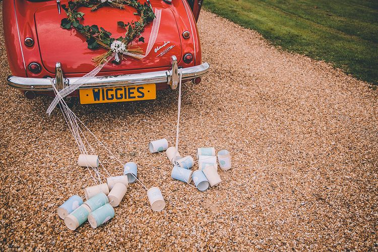 Tin Can Wedding Car Decor | Church Wedding Ceremony | Classic Marquee Wedding at Kimberley Hall in Norfolk | Story + Colour Photography | Driftend Films