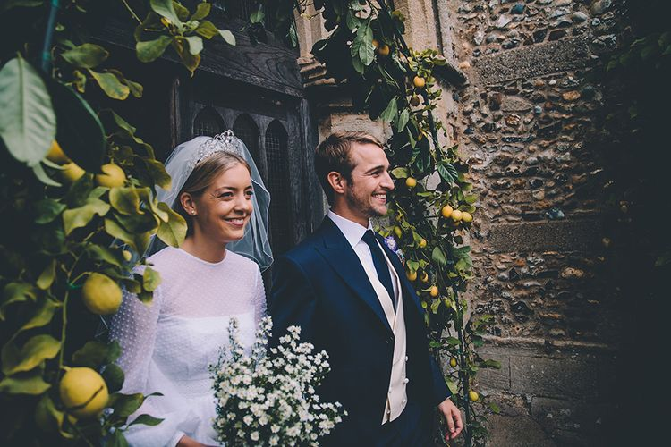 Lemon Tree Arch | Bride in Polka Dot Tulle Eponine London Gown | Groom in Charlie Casey Hayford Suit | Classic Marquee Wedding at Kimberley Hall in Norfolk | Story + Colour Photography | Driftend Films
