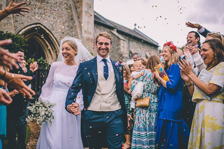 Confetti Exit | Bride in Polka Dot Tulle Eponine London Gown | Groom in Charlie Casey Hayford Suit | Classic Marquee Wedding at Kimberley Hall in Norfolk | Story + Colour Photography | Driftend Films