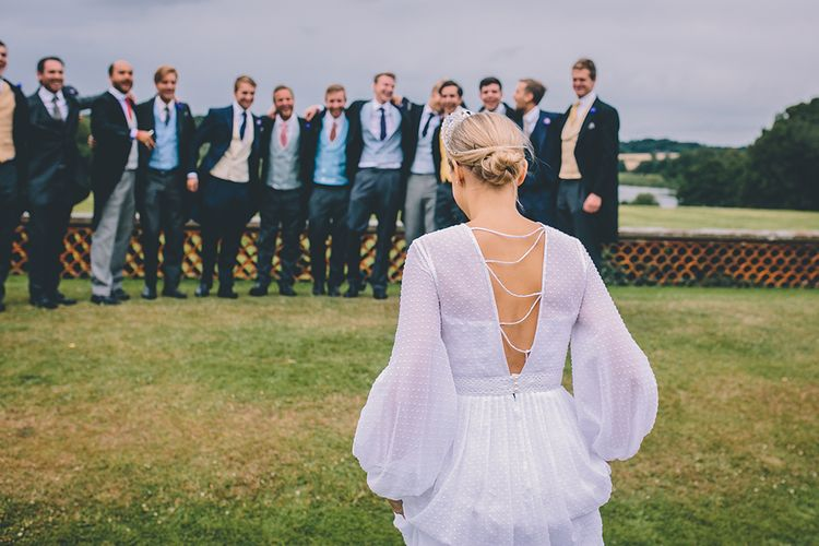 Bride in Polka Dot Tulle Eponine London Gown with Crossover Back | Classic Marquee Wedding at Kimberley Hall in Norfolk | Story + Colour Photography | Driftend Films