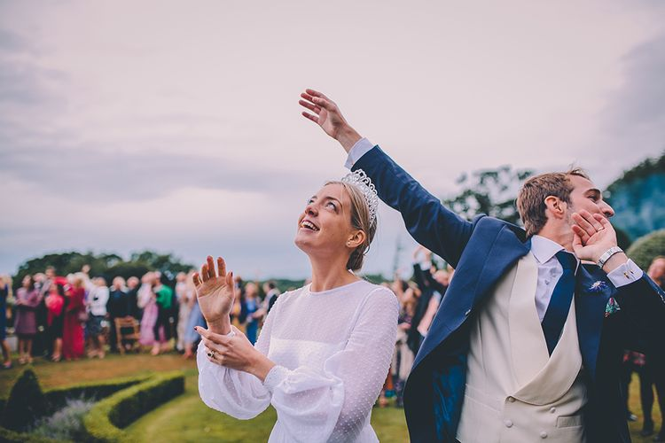 Fly By | Bride in Polka Dot Tulle Eponine London Gown | Groom in Charlie Casey Hayford Suit | Classic Marquee Wedding at Kimberley Hall in Norfolk | Story + Colour Photography | Driftend Films