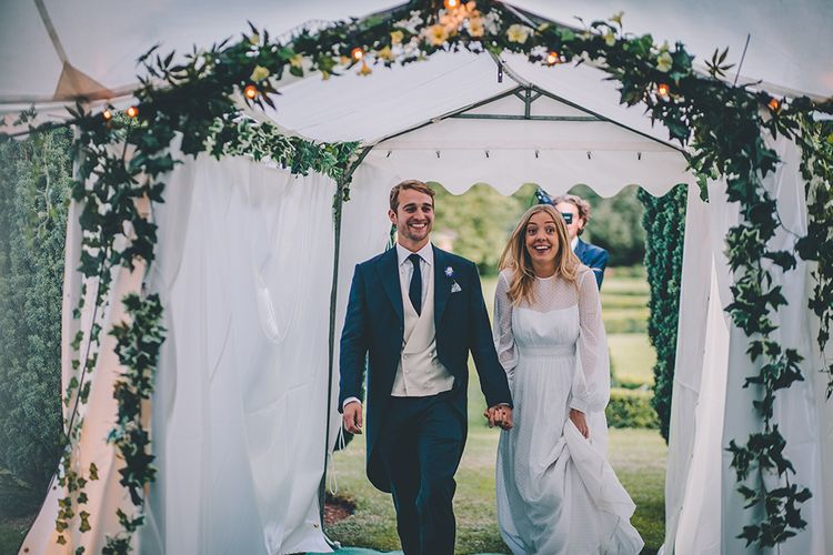 Bride in Polka Dot Tulle Eponine London Gown | Groom in Charlie Casey Hayford Suit | Classic Marquee Wedding at Kimberley Hall in Norfolk | Story + Colour Photography | Driftend Films