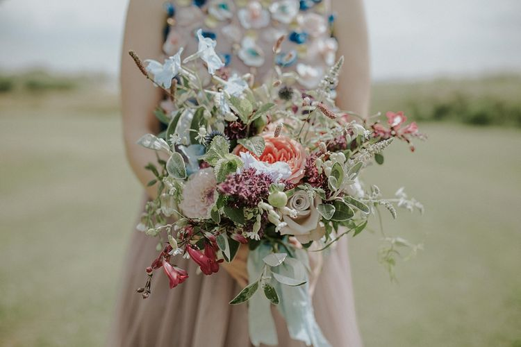 Bridesmaid in Beaded Blush ASOS Gown | Colourful Wild Flower Bouquet by Joanne Truby | Lola Rose Photography