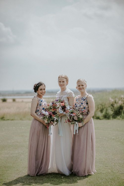 Bride in Alice Temperley Gown | Bridesmaids in Beaded Blush ASOS Dresses | Lola Rose Photography