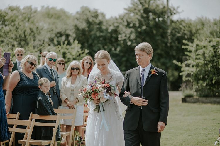 Outdoor Wedding Ceremony at Elmley Nature Reserve | Bride in Alice Temperley Gown | Lola Rose Photography