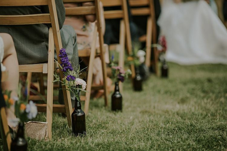 Outdoor Wedding Ceremony at Elmley Nature Reserve | Colourful Wild Flower Arrangement by Joanne Truby | Lola Rose Photography
