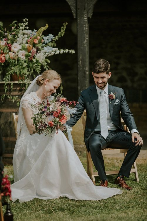 Outdoor Wedding Ceremony at Elmley Nature Reserve | Bride in Alice Temperley Gown | Groom in Edit Suits Co | Lola Rose Photography