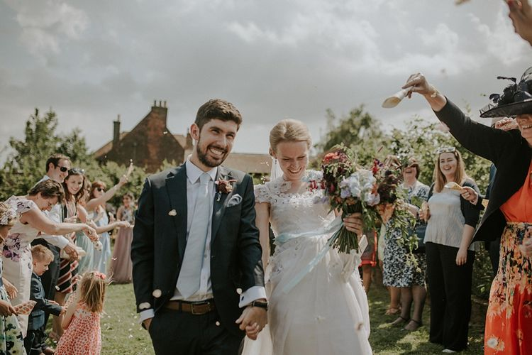 Confetti Moment | Outdoor Wedding Ceremony at Elmley Nature Reserve | Bride in Alice Temperley Gown | Groom in Edit Suits Co | Lola Rose Photography
