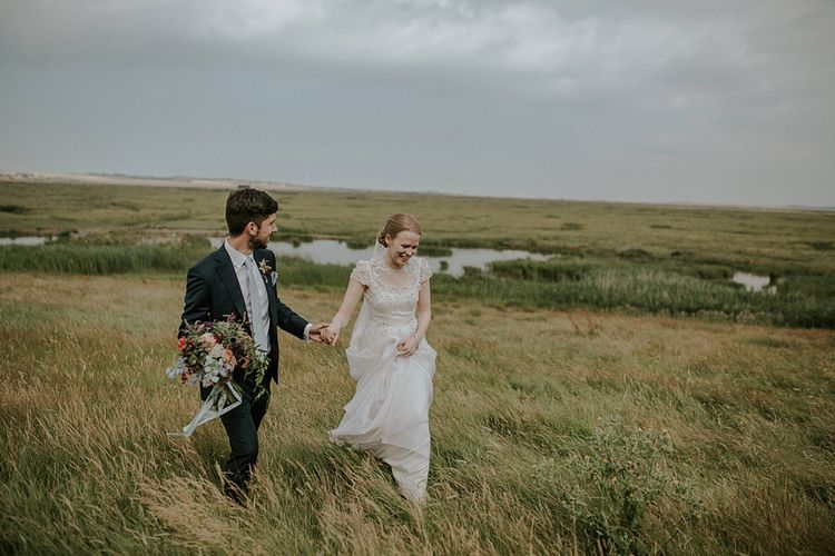 Bride in Alice Temperley Gown | Groom in Edit Suits Co | Lola Rose Photography