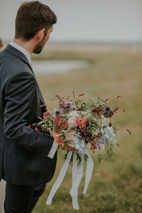 Colourful Wild Flower Bouquet by Joanne Truby | Groom in Edit Suits Co | Lola Rose Photography