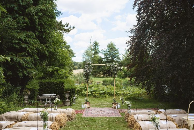 Outdoor Rustic Aisle & Altar with Hay Bales & Rugs