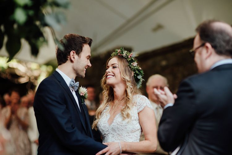 Outdoor Ceremony at Drenagh Estate in Northern Ireland | Bride in Bespoke Suzanne Neville Scarlett Bridal Gown | Protea Bouquet & Flower Crown | The Lou's Photography