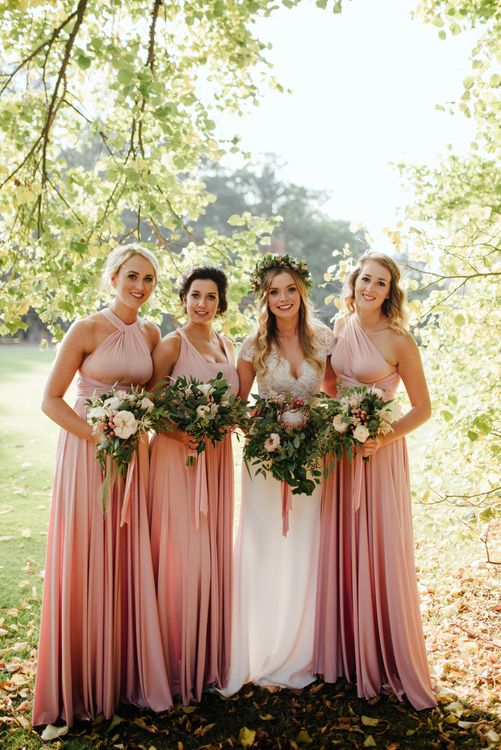Bride in Bespoke Suzanne Neville Scarlett Bridal Gown | Bridesmaids in Pink Twobirds Dresses | The Lou's Photography