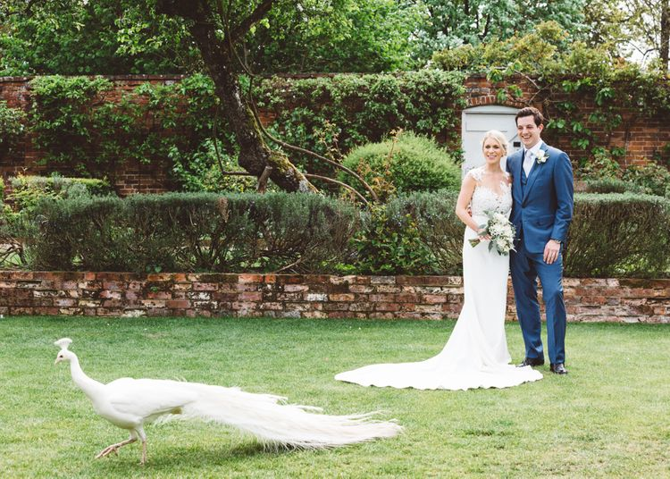 Elegant Pastel Wedding Northbrook Park Rose & Peony Floral Arrangements & Bride In Illusion Lace Dress By Pronovias & Images From Hollie Carlin Photography