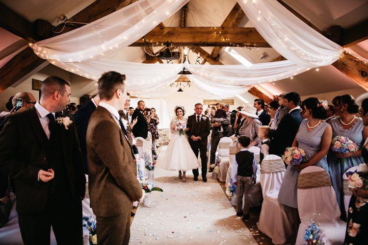 Bridal Entrance | Wedding Ceremony | Bride in Bespoke Something Blue Tea Length Wedding Dress | Pastel Flower Crown & Bouquet | Ally M Photography