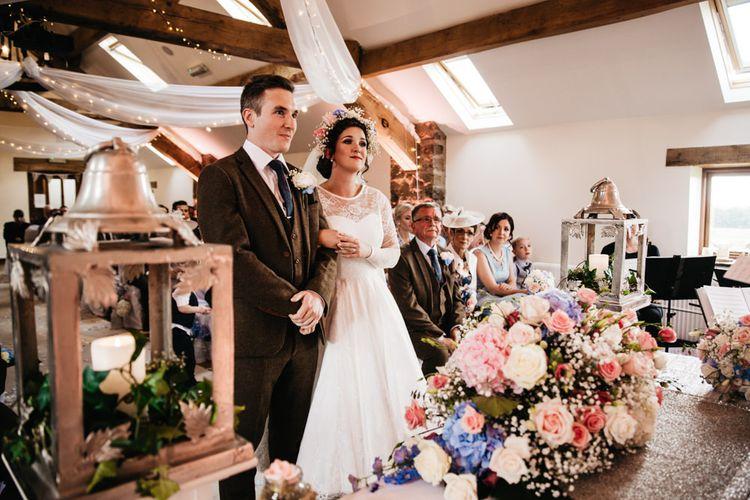 Wedding Ceremony | Bride in Bespoke Something Blue Tea Length Wedding Dress | Pastel Flower Crown & Bouquet | Ally M Photography