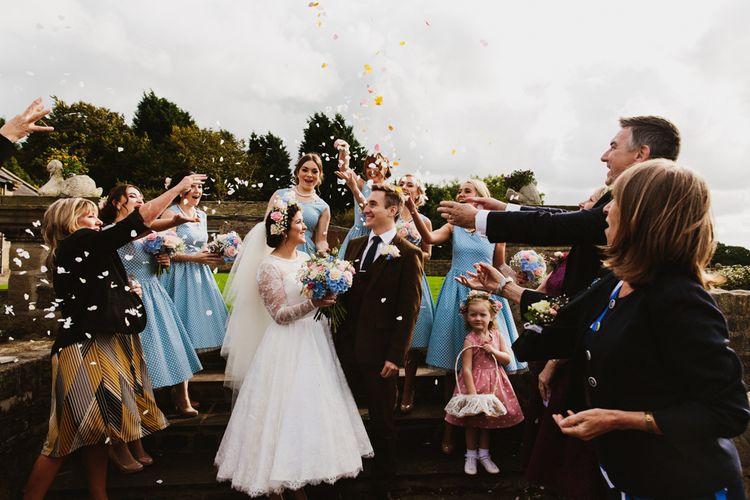 Confetti | Wedding Ceremony | Bride in Bespoke Something Blue Tea Length Wedding Dress | Pastel Flower Crown & Bouquet | Ally M Photography