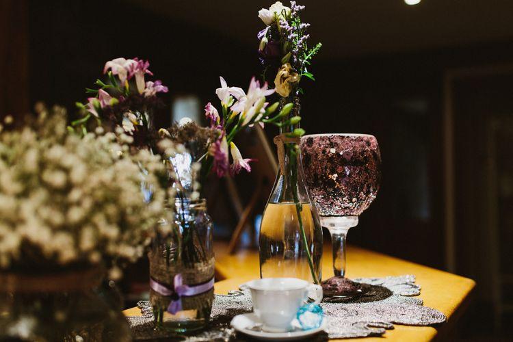 Flower Stems in Bottles Wedding Decor | Ally M Photography