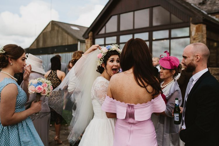 Wedding Guests | Wedding Ceremony | Bride in Bespoke Something Blue Tea Length Wedding Dress | Pastel Flower Crown & Bouquet | Ally M Photography