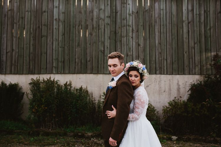 Bride in Bespoke Something Blue Tea Length Wedding Dress | Pastel Flower Crown & Bouquet | Groom in Brown Tweet Suit | Ally M Photography