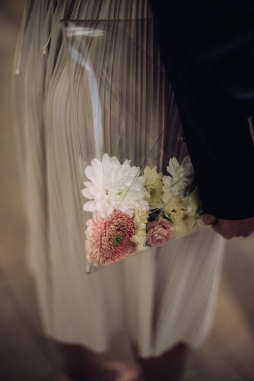 Perspex Pouch With Flowers In Lieu Of Bouquet // Rime Arodaky Bride For A Stylish Artistic & Bohemian French Wedding At La Dime De Giverny France With Images From Paris Wedding Photographer Juli Etta