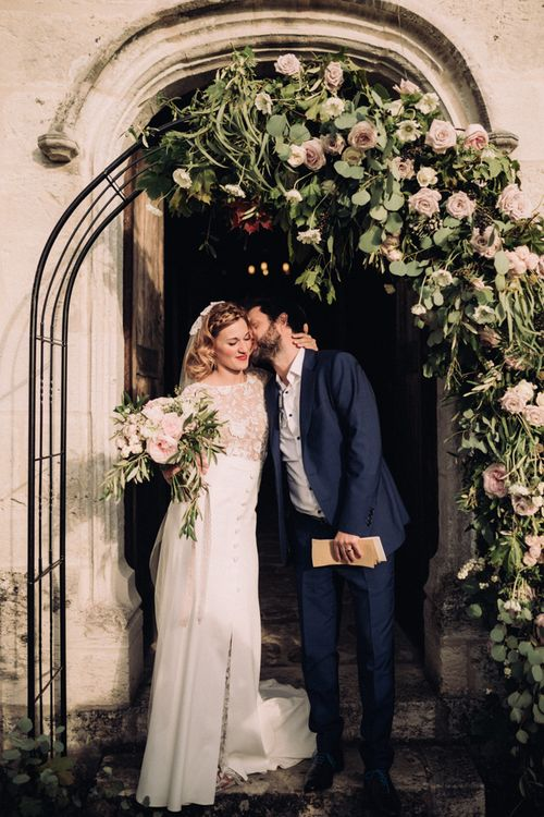 Floral Arch On Church // Rime Arodaky Bride For A Stylish Artistic & Bohemian French Wedding At La Dime De Giverny France With Images From Paris Wedding Photographer Juli Etta