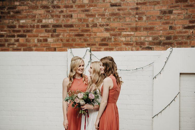 Bridesmaids In Rust Coloured Dresses