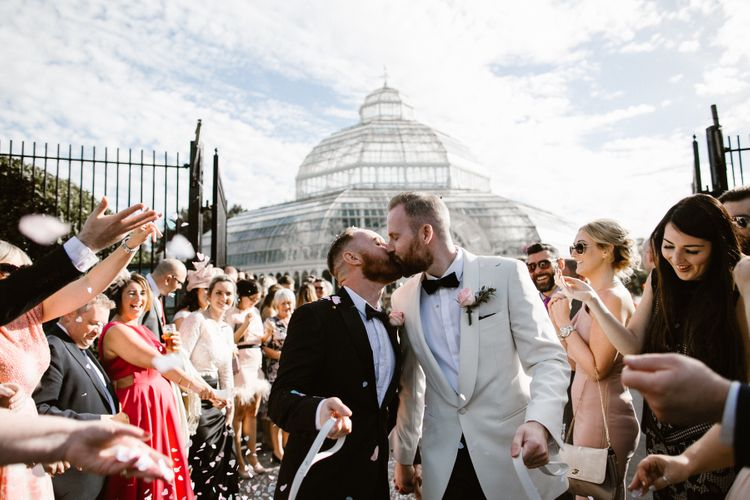 Groom & Groom in Tuxedos outside Sefton Park Palm House in Liverpool