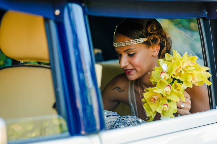 Bride With Orchid Wedding Bouquet