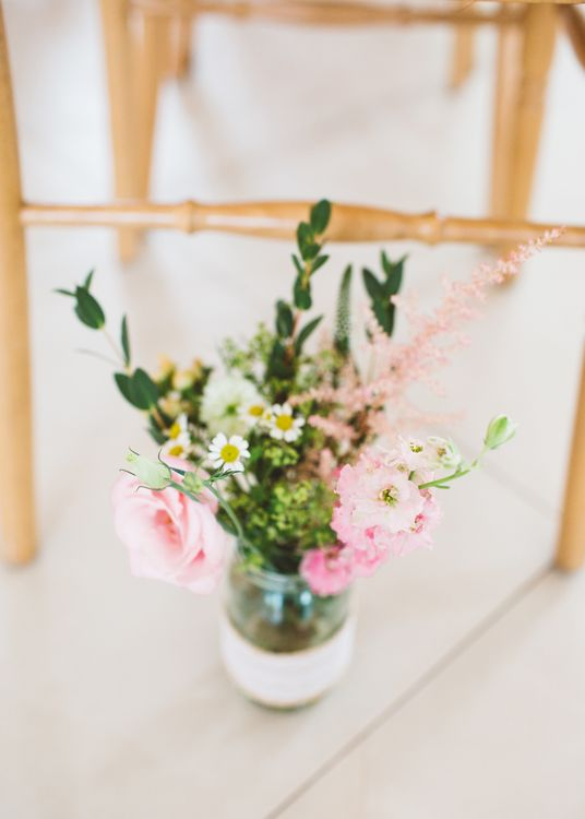 Pink Flower Stems in a Jam Jar as Aisle Flowers