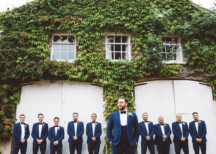 Groomsmen in Navy Suits & Bow Ties