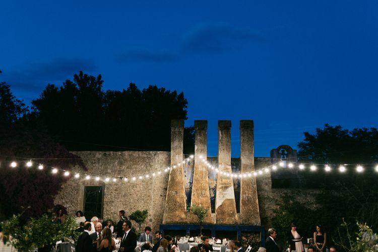 Festoon Lit Outdoor Spanish Wedding Reception