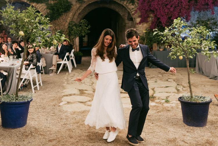 First Dance | Boho Bride in Veronica Miranda Bridal Separates & Flower Crown & Groom in Navy Suit & Bow Tie