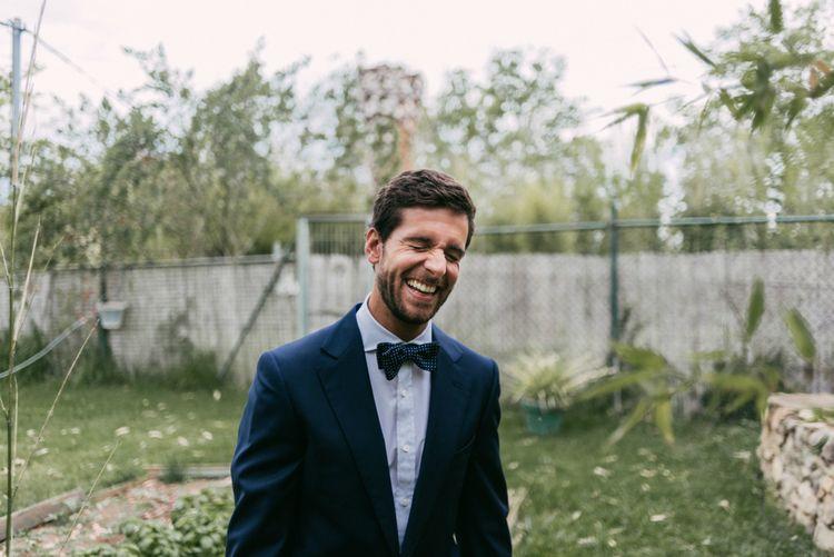 Dapper Groom in Suit & Bow Tie