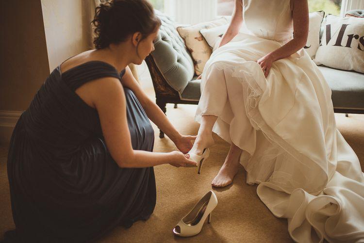 Bride in Tom Flowers Dress & Ivory & Co. Headdress Getting Ready
