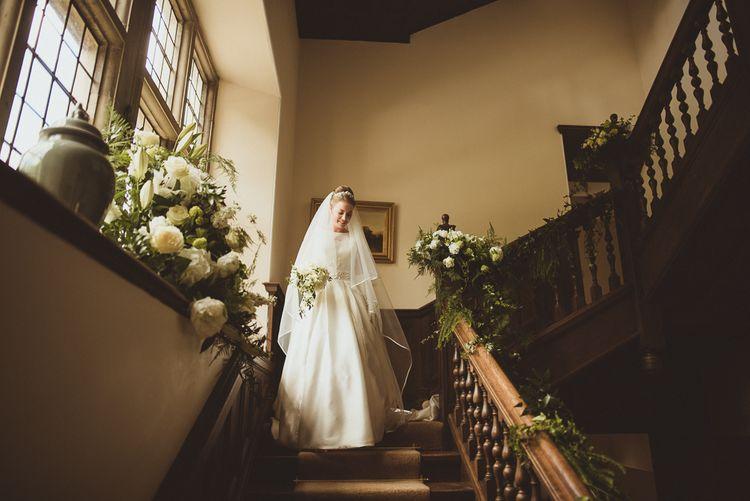 Bride in Tom Flowers Dress, Long Satin Gloves & Ivory & Co. Headdress