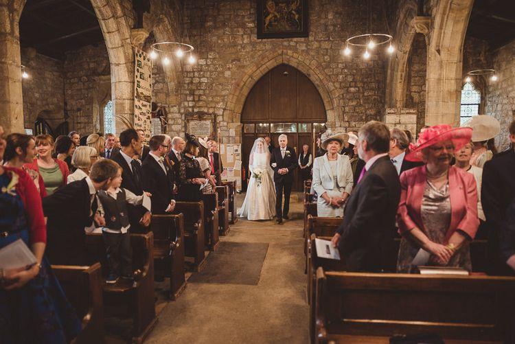 Bride in Tom Flowers Dress, Long Satin Gloves & Ivory & Co. Headdress Church Wedding Ceremony Entrance