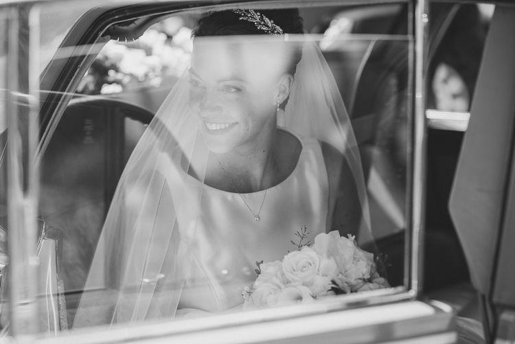 Bride in Tom Flowers Dress, Long Satin Gloves & Ivory & Co. Headdress in the Wedding Car