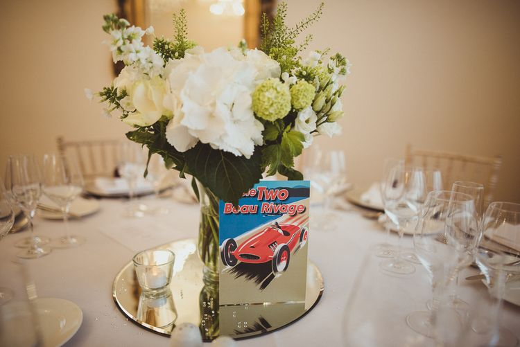 White Floral Centrepieces with Car Table Name