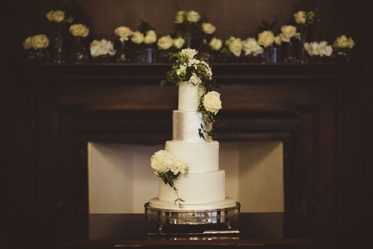 Four Tier Wedding Cake with Silver Layer & White Flowers